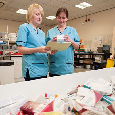 Two nurses in hospital pharmacy