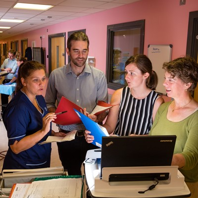 Clinical staff on ward, discussion